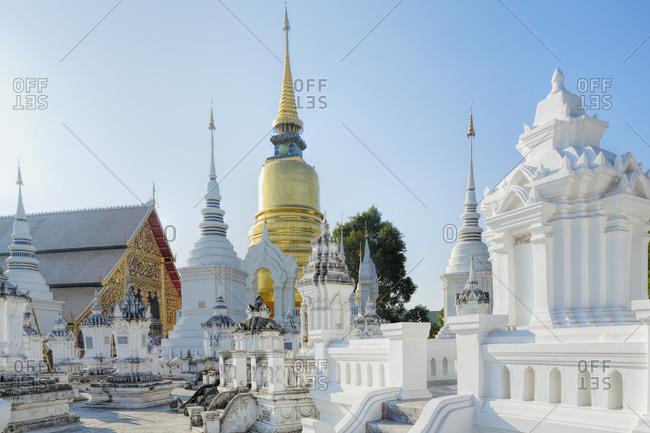 Wat Chiang Man, Chiang Mai, Thailand - March 4, 2014: Chedis (stupas) at the temple of Wat Suan Dok, Chiang Mai, Thailand, Southeast Asia