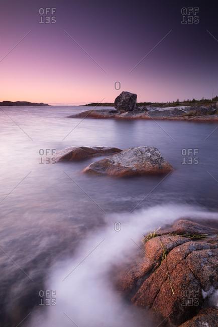 Dusk at a bay in Fogo Island, Canada