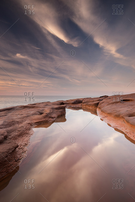 Clouds reflecting in a tidal pool in Cavendish, Prince Edward Island, Canada