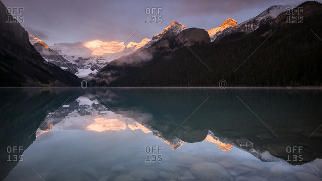 Mountains reflecting in Lake Louise, Alberta, Canada