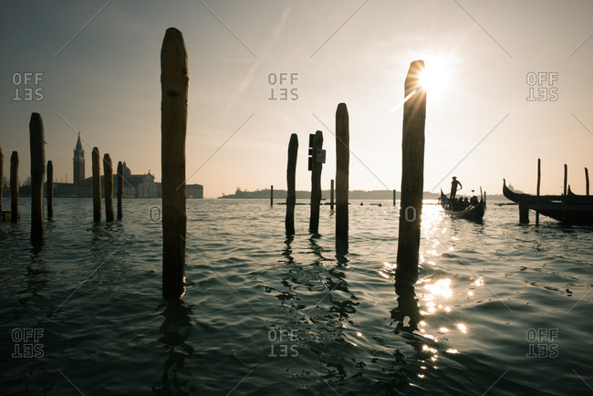 Venice, Italy - December 25, 2014: Gondolier rowing tourists along the Grand Canal