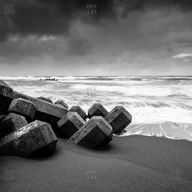 Wave breakers on the beach in Hokkaido, Japan