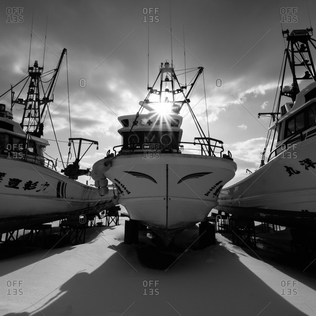 Hokkaido, Japan - January 13, 2015: Fishing boats during winter