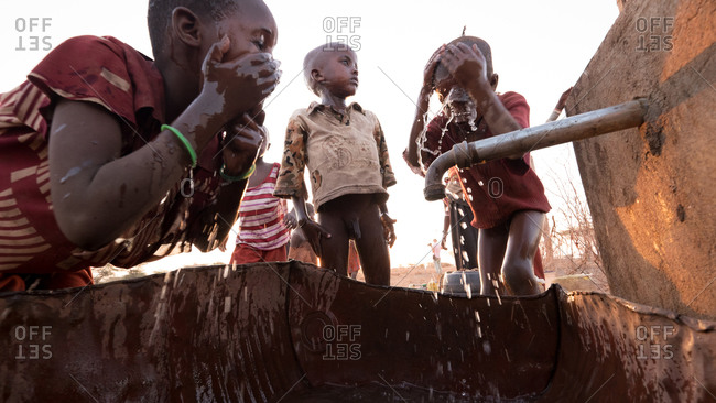 Northern Kenya -  February 19, 2015: Children washing their faces at a borehole