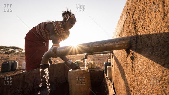 Northern Kenya - February 19, 2015: Woman fetching water from a borehole