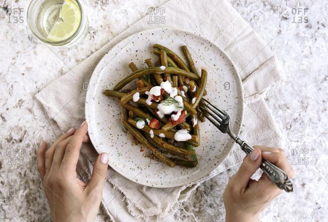 Eating Mediterranean-style green bean dish