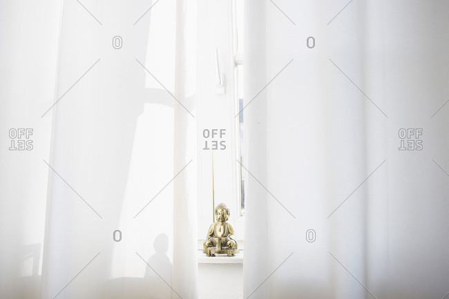 Little Buddha statue on a window sill
