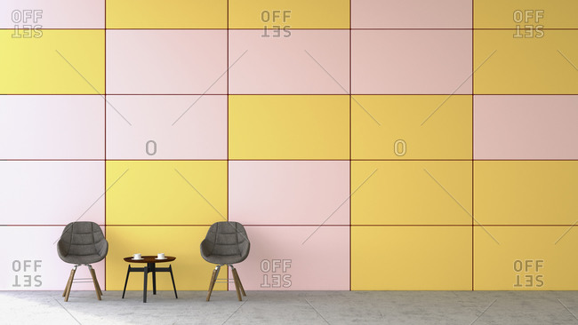 Waiting area with two chairs and a side table in front of colored wall, 3D Rendering