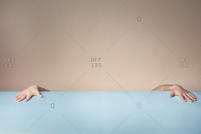 Male hands flat on a table