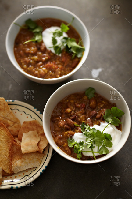 Bowls of pinto beans served with tortilla chips