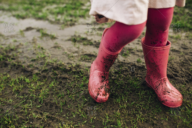 Muddy boots and tights on girl