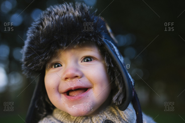 Portrait of toddler with runny nose outside