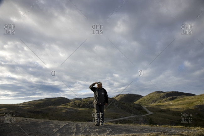 A man walking along a country path