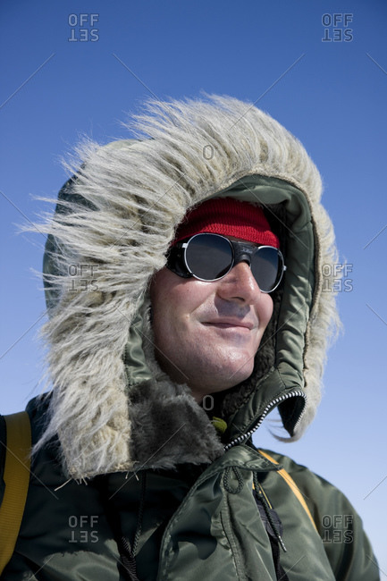 A man dressed for hiking in cold weather