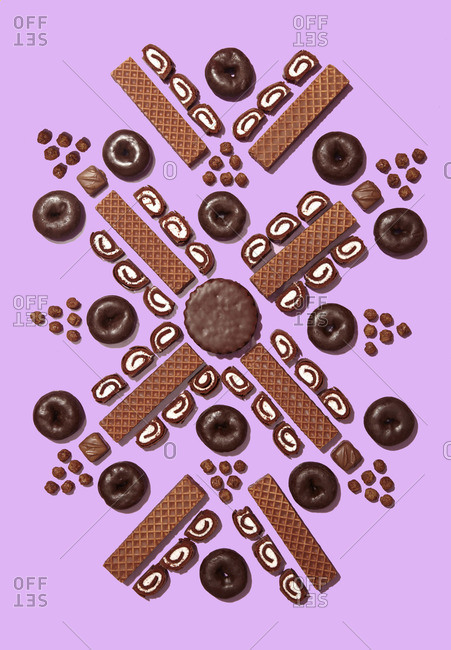 Chocolate-flavored snacks on pink background