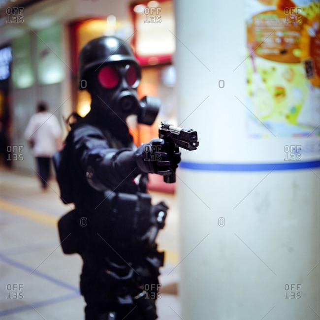 Cosplayer pointing a gun in Nagoya, Japan
