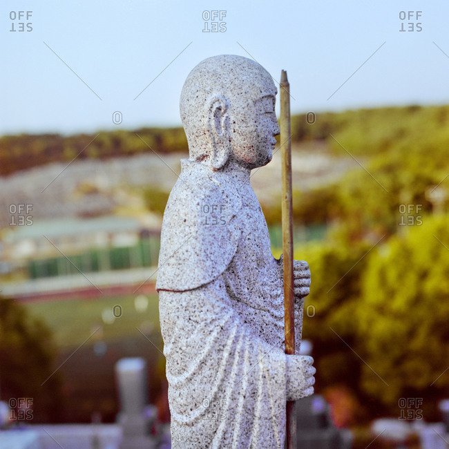 Buddhist  statue in a cemetery, Nagoya, Japan