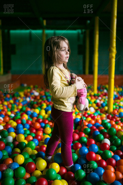 A little girl in a ball pit