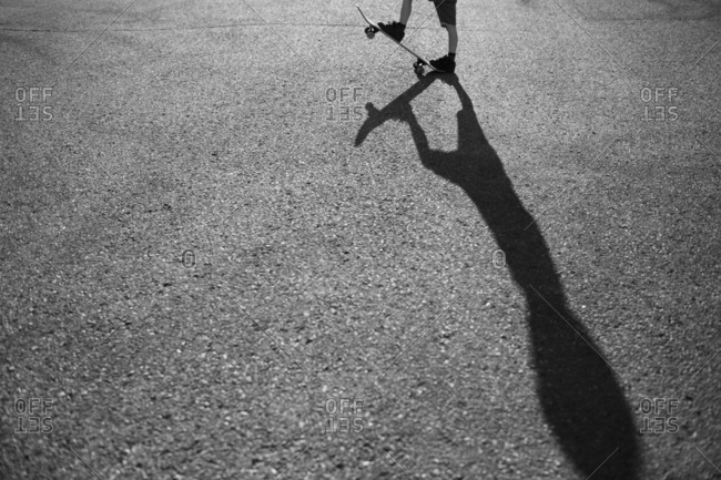 Black and white of skateboarder and shadow