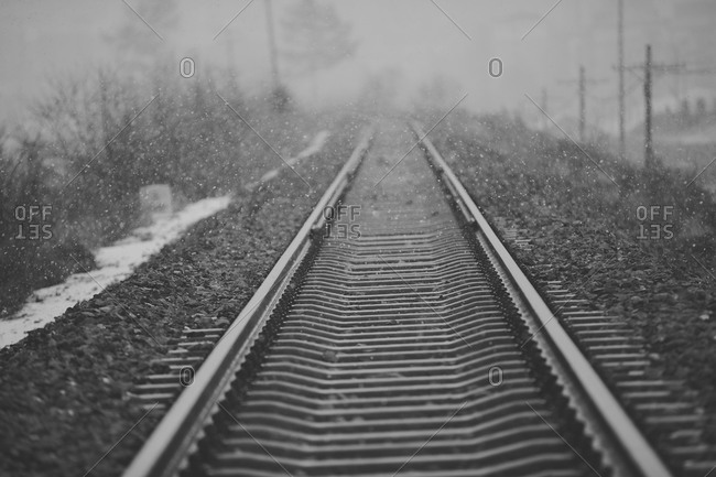 Snow falls on railroad tracks, close up
