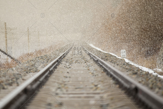 Snow falling on railroad tracks