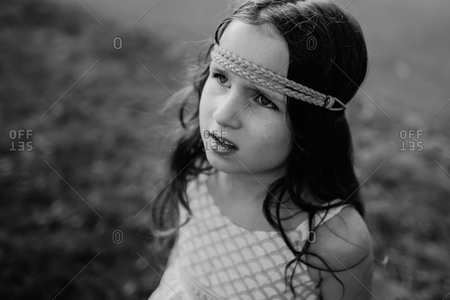 Portrait of a young girl with freckles wearing a sundress and headband