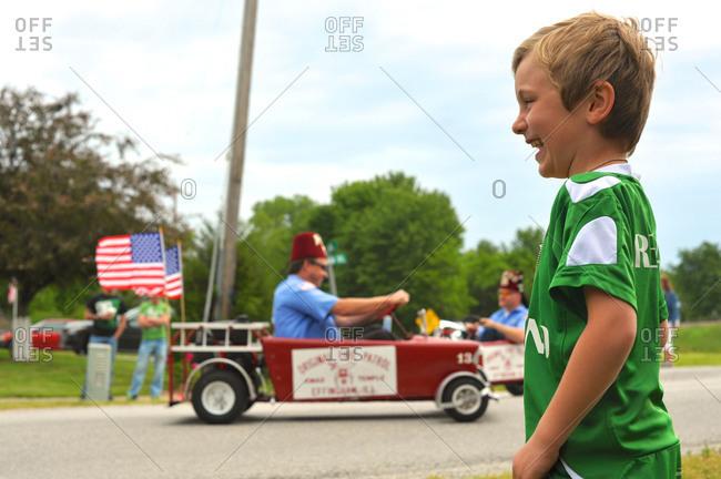 Little boy enjoying a parade