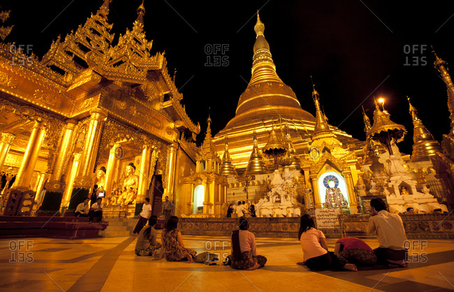 Yangon, Myanmar - August 16, 2011: People in Shwedagon Paya, Yangon, Myanmar