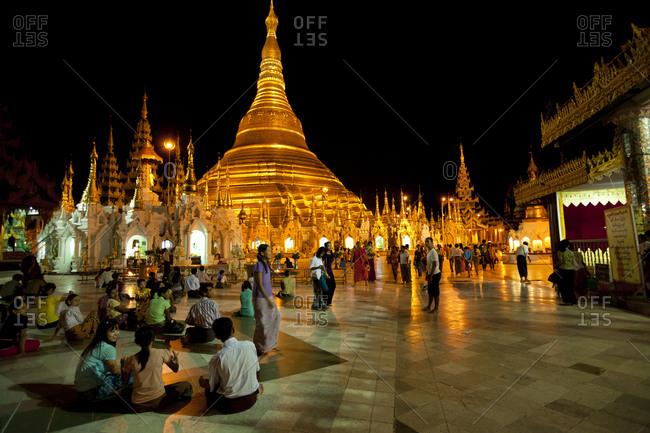 Yangon, Myanmar - August 16, 2011: Visitors in Shwedagon Paya, Yangon, Myanmar