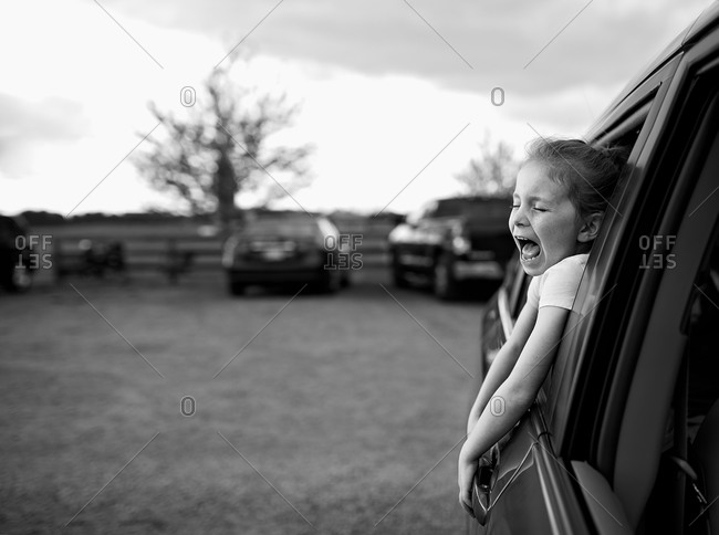 Girl screaming out car window