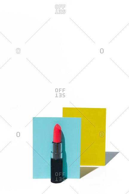 Tube of lipstick in still life with rectangles