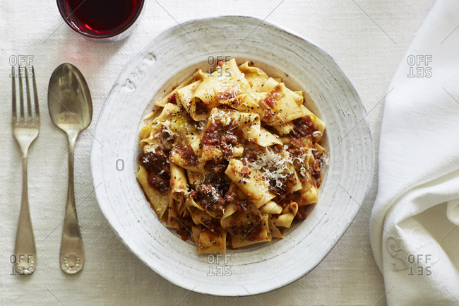 Overhead view of pappardelle with sausage and tomato sauce