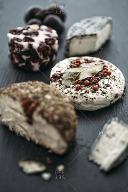 Different sorts of goat's cheese on slate