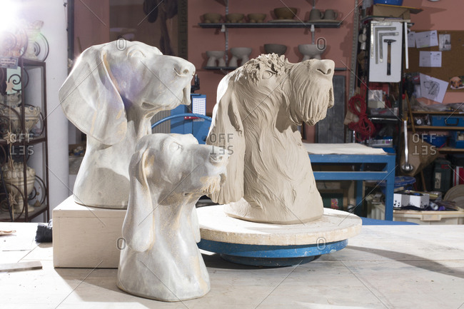 Ceramic dog figurines in potter's workshop