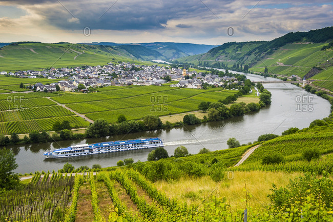 Excursion ship passing river bend at Trittenheim, Moselle valley