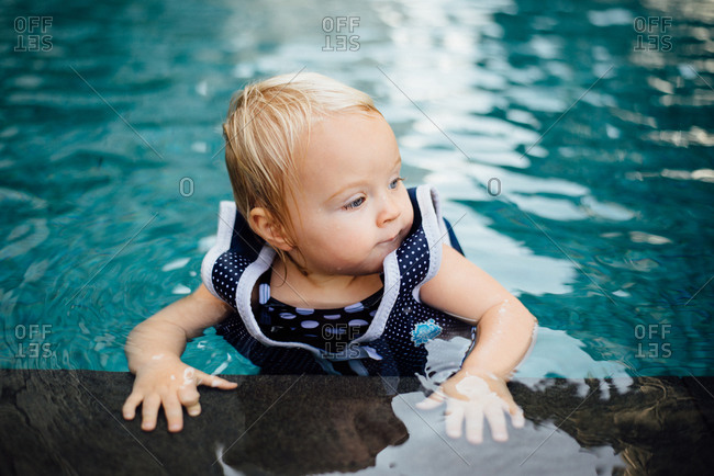 Portrait of a little girl at a poolside