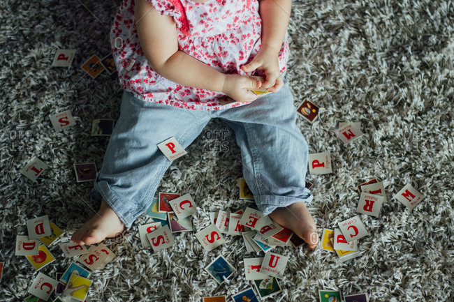 Young girl playing with flesh cards