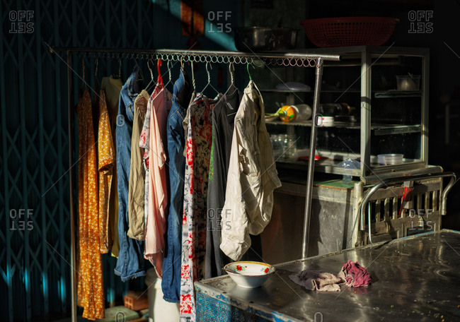 Saigon, Vietnam - November 15, 2014: Clothes hanging outside a street cart