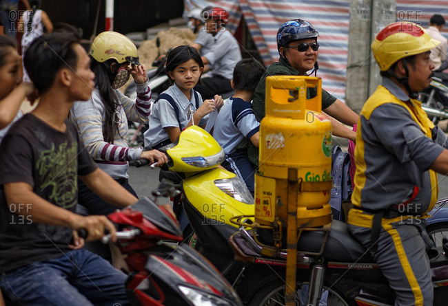 Saigon, Vietnam - November 17, 2014: Group of scooters in traffic