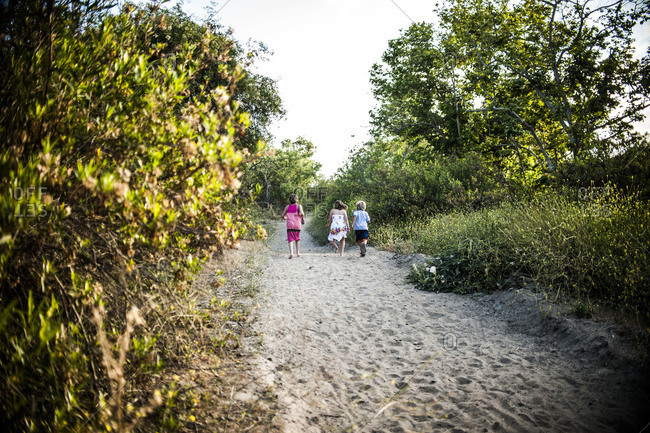 Children walking on a dirt road