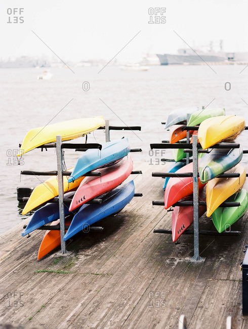 Canoes on rack in harbor