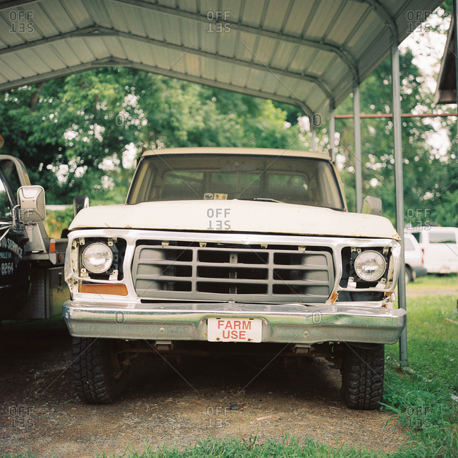 Farm truck parked under carport