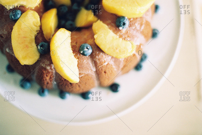 Bundt cake with blueberries and mangos from above