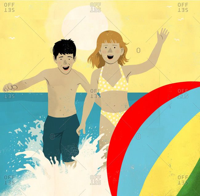 Boy and girl splash after beach ball