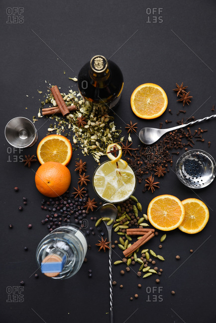 Overhead view of ingredients for a spiced orange cocktail