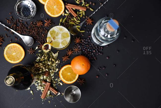 Overhead of ingredients for a spiced orange mixed drink