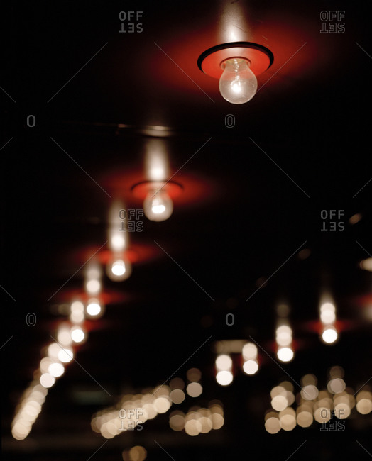 Rows of light bulbs on a red ceiling