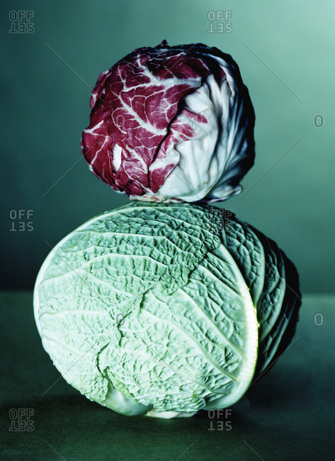 Red cabbage stacked on green cabbage