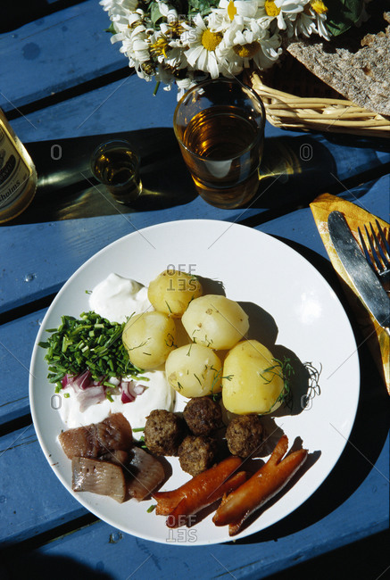 A plate filled with traditional midsummer Swedish food