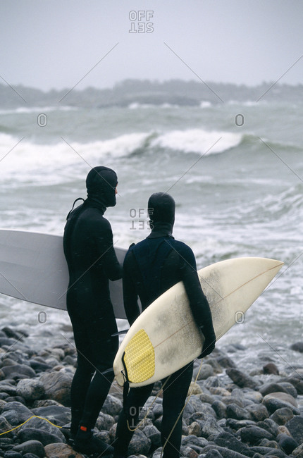 Surfers in stormy weather